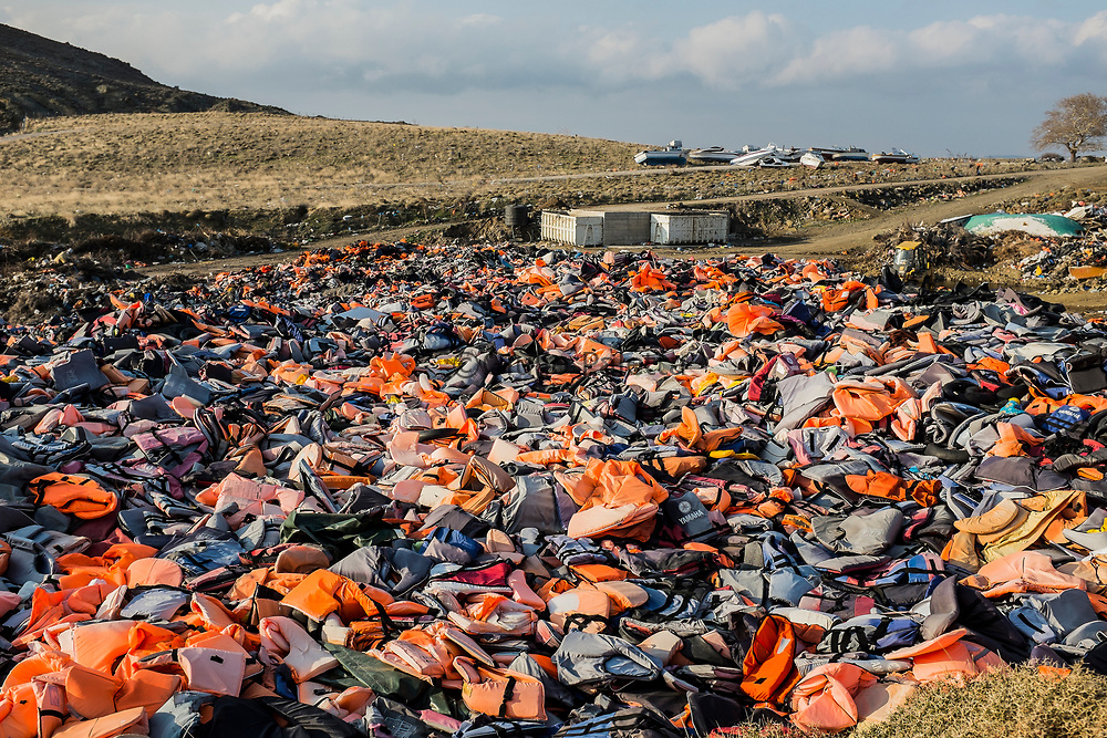 Isabel, 38 years old, from Mexico, head of the recycling and upcycling project of the Swedish NGO Lighthouse Relief called ECO Relief. Here photographed inside the surreal and touching life jackets cemetery created near Molyvos, in the north-west of Lesbos. Here have been collected all the life jackets and personal belongings left by the refugees