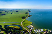 Nederland, Noord-Holland, Gemeente Edam-Volendam, 13-06-2017; Edam met Fort bij Edam en Zeevangse Zeedijk.<br /> De dijk staat op de nominatie om verstrekt te worden, bewoners en actievoerders vrezen aantasting van de monumentale dijk en verlies culturele waarden.<br /> Edam with Fort at Edam and Zeevangse Zeedijk.<br /> The dike is nominated to be reinforced, residents and activists fear losing the monumental quality of the dike and losing other cultural values.<br /> <br /> luchtfoto (toeslag op standaard tarieven);<br /> aerial photo (additional fee required);<br /> copyright foto/photo Siebe Swart