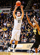 WEST LAFAYETTE, IN - JANUARY 27: D.J. Byrd #21 of the Purdue Boilermakers passes the ball off against the Iowa Hawkeyes at Mackey Arena on January 27, 2013 in West Lafayette, Indiana. Purdue defeated Iowa 65-62 in overtime. (Photo by Michael Hickey/Getty Images) *** Local Caption *** D.J. Byrd