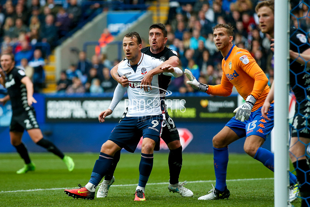 Bolton Wanderers forward Adam Le Fondre (9) is closely marked at a corner by Leeds United midfielder Pablo Hernandez (19)  during the EFL Sky Bet Championship match between Bolton Wanderers and Leeds United at the Macron Stadium, Bolton, England on 6 August 2017. Photo by Simon Davies.