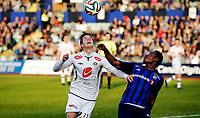 Fotball<br /> Tippeligaen<br /> Nadderud 30.03.14<br /> Stabæk - Sogndal<br /> Ruben Holsæter i duell med Enock Adu<br /> Foto: Eirik Førde