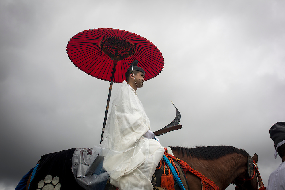 "MINAMISOMA, JAPAN - JULY 24 :  A shinto priest is seen parade during the ""Hon Matsuri"", Soma Nomaoi festival at Hibarigahara field on Sunday, July 24, 2016 in Minamisoma, Fukushima Prefecture, Japan. ""Soma-Nomaoi"" is a three day traditional festival that recreates a samurai battle scene from more than 1,000 years ago. The festival has gathered more than thousands visitors as Fukushima still continues to recovery from the 2011 nuclear disaster, the samurai warriors battles for recovery of the area. (Photo: Richard Atrero de Guzman/NURPhoto)"