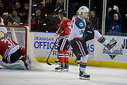 KELOWNA, CANADA - JANUARY 21:  Kelowna Rockets right wing Kole Lind #16, Portland Winterhawks center Ilijah Colina #12 and Portland Winterhawks goalie Cole Kehler #31 at the Kelowna Rockets game on January 21, 2017 at Prospera Place in Kelowna, British Columbia, Canada.  (Photo By Cindy Rogers/Nyasa Photography,  *** Local Caption ***