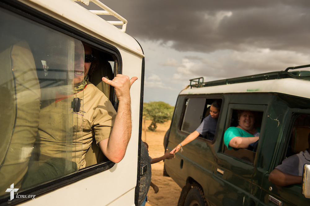 Christopher Curtis, a travel nurse from St. Louis, waves goodbye to patients following a day at the LCMS Mercy Medical Team on Tuesday, June 21, 2016, in Nataparkakono, a village in Turkana, Kenya.  LCMS Communications/Erik M. Lunsford