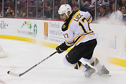 Jan 19; Newark, NJ, USA; Boston Bruins left wing Milan Lucic (17) skates during the first period of their game against the New Jersey Devils at the Prudential Center.