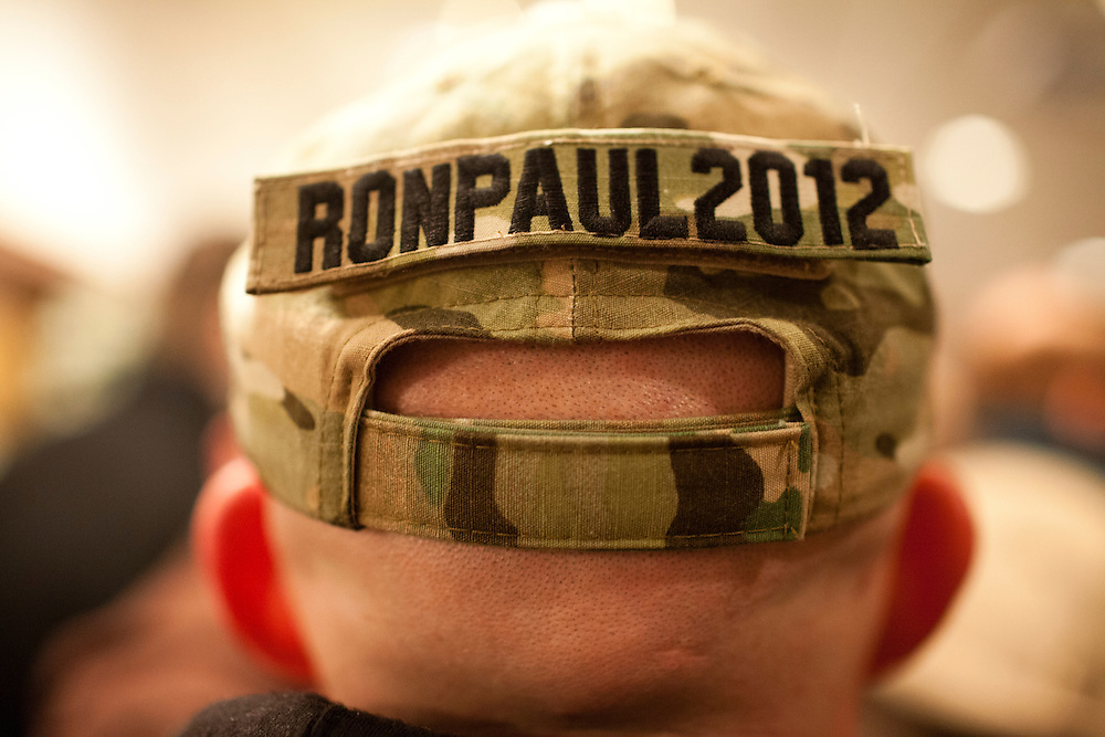Ian Hickey, a U.S. Army specialist from Plympton, Massachusetts, awaits the start of Republican presidential candidate Ron Paul's primary night rally at the Executive Court banquet facility on Tuesday, January 10, 2012 in Manchester, NH. Brendan Hoffman for the New York Times