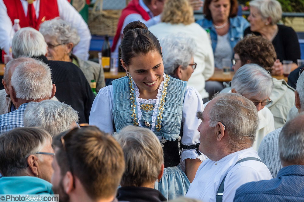 Swiss celebrate National Day with costumes at a feast and concert in Appenzell village, Switzerland, Europe. Appenzell Innerrhoden is Switzerland's most traditional and smallest-population canton (second smallest by area). For licensing options, please inquire.