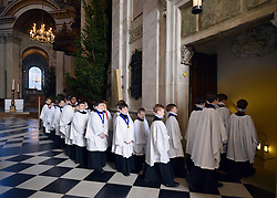 © Licensed to London News Pictures. 10/12/2012. City of London, UK Boys leave after the service to return to school. A photo call for St Paul's Choristers preparing for their busiest weeks of the year. The choristers will rehearse Christmas favourites, under the direction of Andrew Carwood, Director of Music. St Paul's Cathedral. today 10 December 2012. Photo credit : Stephen Simpson/LNP