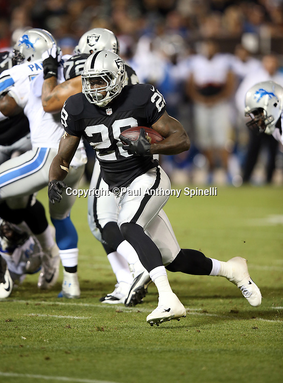 Oakland Raiders running back Latavius Murray (28) runs the ball during the 2014 NFL preseason football game against the Detroit Lions on Friday, Aug. 15, 2014 in Oakland, Calif. The Raiders won the game 27-26. ©Paul Anthony Spinelli