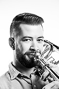 Brian Hecht<br /> Navy<br /> E-6<br /> Musician (Bass Trombone)<br /> 10/27/09-10/26/13<br /> <br /> Photo by Stacy Pearsall