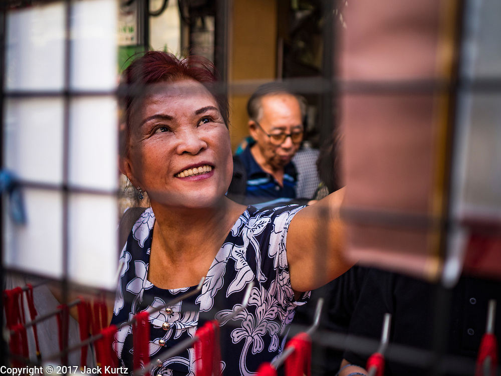 """18 JANUARY 2017 - BANGKOK, THAILAND: People shop for Chinese New Year supplies in Bangkok's Chinatown district. Chinese New Year, also called Lunar New Year or Tet (in Vietnamese communities) starts Saturday, 28 January. The coming year will be the """"Year of the Rooster."""" Thailand has the largest overseas Chinese population in the world; about 14 percent of Thais are of Chinese ancestry and some Chinese holidays, especially Chinese New Year, are widely celebrated in Thailand.       PHOTO BY JACK KURTZ"""