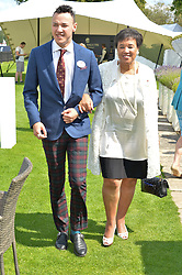 BARONESS SCOTLAND and her son BEN MAWHINNEY at The Royal Salute Coronation Cup Polo held at Guards Polo Club,  Smiths Lawn, Windsor Great Park, Egham on 23rd July 2016.