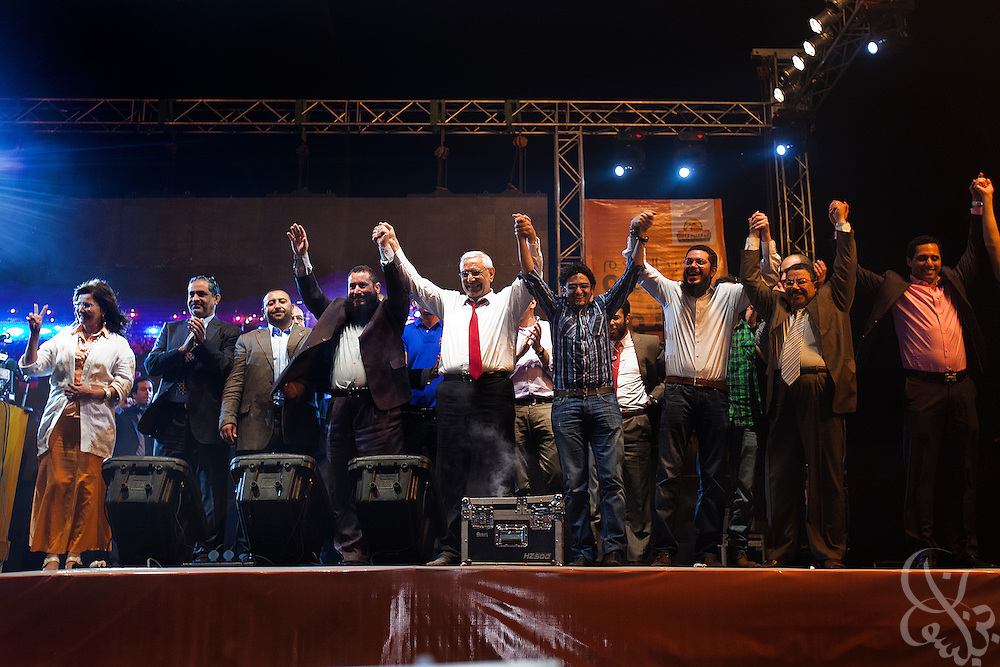 Egyptian Islamist presidential candidate Abdul Moneim Aboul Fotouh (c) is joined on stage by a group of diverse intellectuals, activists, Islamist political figures and celebrities during a May 18, 2012 campaign rally in the Gezira district of Cairo, Egypt.  (Photo by Scott Nelson)