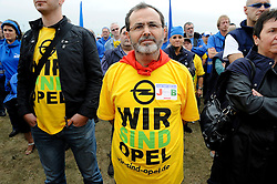 More than 2,000 Opel workers and union leaders from across Europe, take part in a demonstration to protest against the threatened closure of the carmaker's plant in Belgium, outside the Opel assembly plant in Antwerp, Wednesday, Sept. 23, 2009.  (Photo © Jock Fistick)