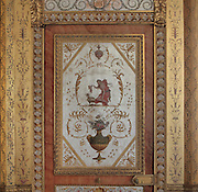 Painted decorative door disguised as a wall panel in the Boudoir de la Reine or Silver Bedroom, designed by the architect Pierre-Marie Rousseau, 1751-1829, used by Marie-Antoinette in the Queen's Apartments, Chateau de Fontainebleau, France. The paintings are by Michel-Hubert Bourgois and Jacques-Louis-Francois Touze. The Palace of Fontainebleau is one of the largest French royal palaces and was begun in the early 16th century for Francois I. It was listed as a UNESCO World Heritage Site in 1981. Picture by Manuel Cohen