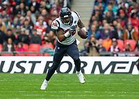 American Football - 2019 NFL Season (NFL International Series, London Games) - Houston Texans vs. Jacksonville Jaguars<br /> <br /> Jordan Akins, Tight End, (Houston Texans) sets off after receiving the ball at Wembley Stadium.<br /> <br /> COLORSPORT/DANIEL BEARHAM