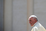 Pope Francis waves to pilgrims while leaving his weekly general audience in St Peter's square at the Vatican on April 25, 2018.
