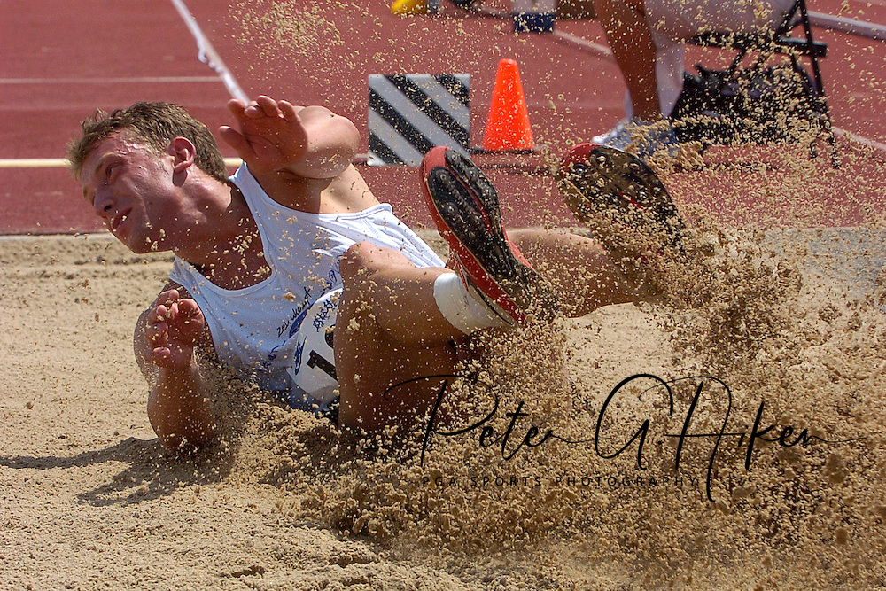 Germany's Marian Geisler kicks up some sand on his landing in the long jump, at the Nike Combined Events Challenge at the R.V. Christian Track Complex on the campus of Kansas State University in Manhattan, Kansas, August 5, 2006.