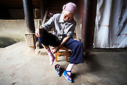 August 2009 - Yunnan Province, China - In a remote part of the province several villages still have the last remaining women who still have bound feet. Now very old, they are the last reminder of this ancient Chinese traditional. Photo credit: Luke Duggleby