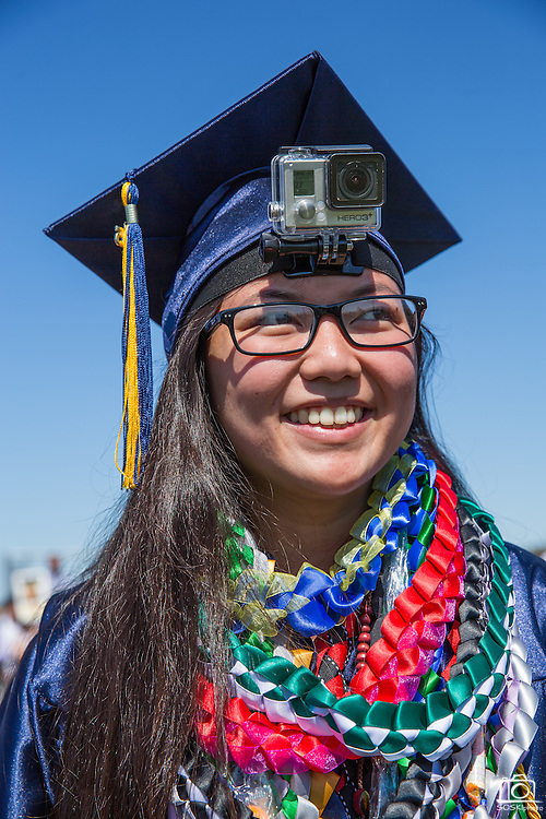 Snare Monreal poses for a portrait with a GoPro camera attached to her head during the graduation ceremony at Milpitas High School in Milpitas, California, on June 6, 2015. (Stan Olszewski/SOSKIphoto)