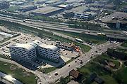 Nederland, Utrecht, Veenendaal, 04-04-2002; afrit autosnelweg A12 met bedrijven terrein / kantoorpark plus de onvermijdelijke MacDonalds; verschimmeling van het landschap; snelwegarchitectuur, hamburgerketen fastfood franchise;<br /> luchtfoto (toeslag), aerial photo (additional fee)<br /> photo/foto Siebe Swart