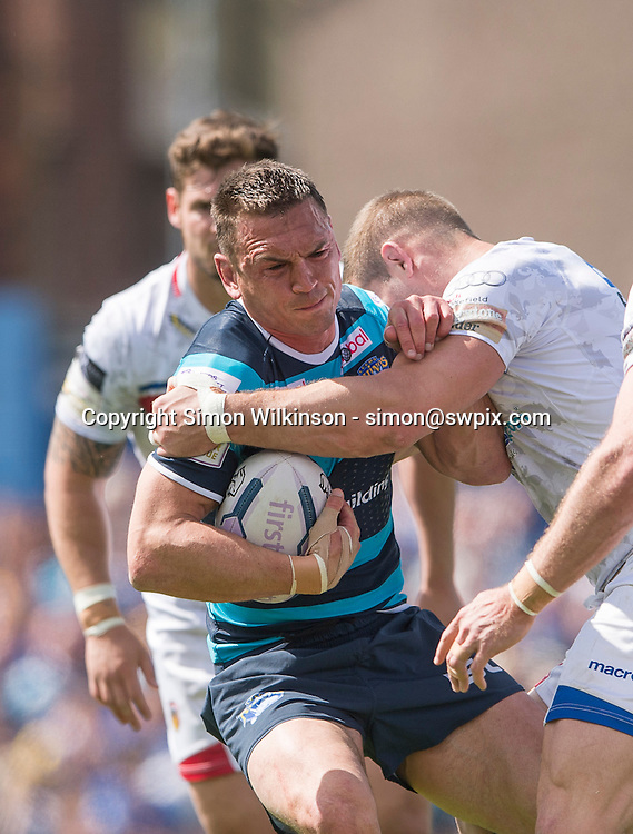 Picture by Allan McKenzie/SWpix.com - 07/06/2015 - Rugby League - First Utility Super League - Wakefield Trinity Wildcats v Leeds Rhinos - Rapid Solicitors Stadium, Wakefield, England - Leeds's Kevin Sinfield is tackled by Wakefield's Danny Washbrook.