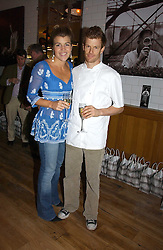 TOM AIKENS and AMBER NUTTALL at the opening party for Tom's Kitchen - the restaurant of Tom Aikens at 27 Cale Street, London SW3 on 1st November 2006.<br /><br />NON EXCLUSIVE - WORLD RIGHTS