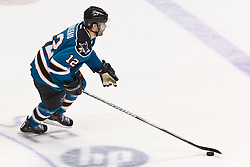 Jan 17, 2012; San Jose, CA, USA; San Jose Sharks left wing Patrick Marleau (12) skates with the puck against the Calgary Flames during shootouts at HP Pavilion. San Jose defeated Calgary 2-1 in shootouts. Mandatory Credit: Jason O. Watson-US PRESSWIRE