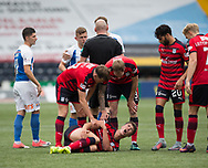 23rd September 2017, Rugby Park, Kilmarnock, Scotland; SPFL Premiership football, Kilmarnock versus Dundee; Dundee's Jack Hendry in pain after being brought down by Kilmarnock's Calum Waters