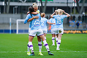 Manchester City Women forward Tessa Wullaert (25) scores a goal and celebrates with Manchester City Women defender Steph Houghton (captain) (6) to make the score 2-0 during the FA Women's Super League match between Manchester City Women and BIrmingham City Women at the Sport City Academy Stadium, Manchester, United Kingdom on 12 October 2019.