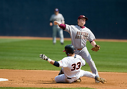 Virginia Cavaliers C Franco Valdes (33) is called out after interfering with Boston College shortstop Garrett Smith as he tries to turn a double play.  The #19 ranked Virginia Cavaliers baseball team defeated the Boston College Golden Eagles 5-4 in 10 innings at the University of Virginia's Davenport Field in Charlottesville, VA on March 22, 2008.