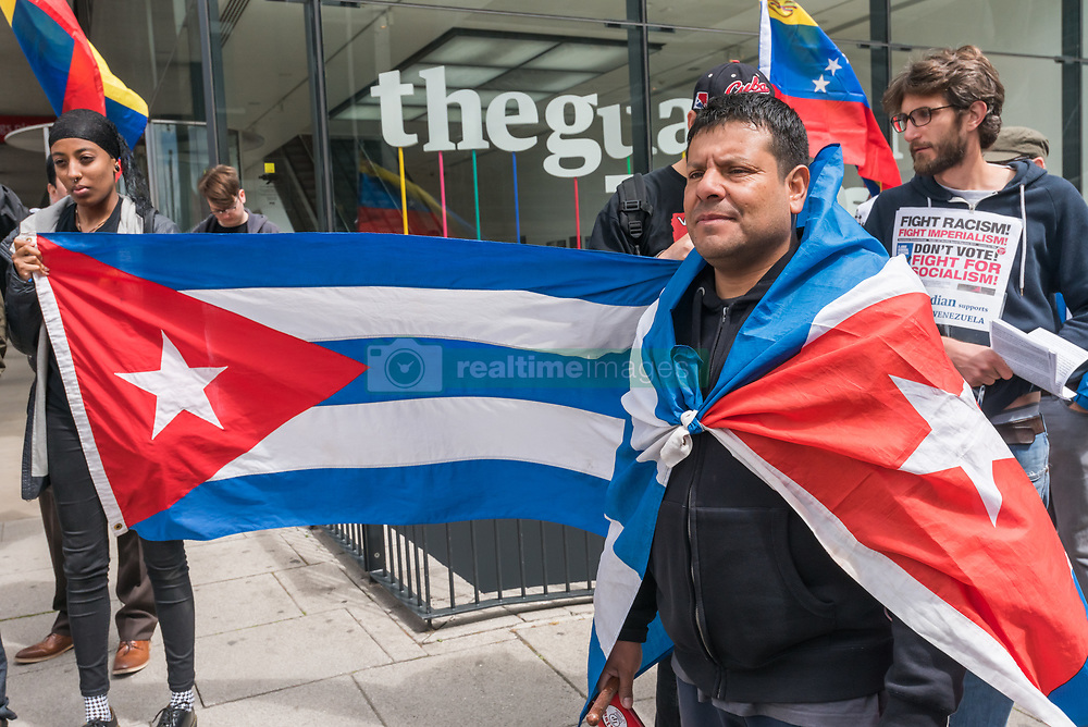 May 20, 2017 - London, UK - London, UK. 20th May 2017. People protest outside The Guardian in London calling for an end to the lies and censorship of the UK press about the events in Venezuela. They say that the current unrest is a right-wing coup attempt to overthrow President Maduro and the working class Bolivarian revolution, backed by the US, which the privately-owned Venezuelan press misrepresents as 'pro-democracy' protests and fails to report their attacks on hospitals, schools and socialist cities which have led to many deaths. The protest was at The Guardian as that paper recently called for democratically-elected socialist president Nicolas Maduro to be given 'pariah status', constantly backed attempts to undermine former President Chavez and has failed to report the mass mobilisations by working-class supporters to protect the government and its reforms which have decreased poverty, provided free health care and education, devolved power into the hands of local collectives and built homes for the working class. The protest was opposed by a small group of Venezualans who called Maduro a murderer. Peter Marshall ImagesLive (Credit Image: © Peter Marshall/ImagesLive via ZUMA Wire)