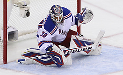 May 21, 2012; Newark, NJ, USA; New York Rangers goalie Henrik Lundqvist (30) makes a blocker save during the first period in game four of the 2012 Eastern Conference Finals at the Prudential Center.