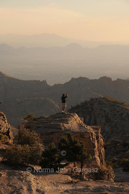 A tourist visits Windy Point Vista, Mount Lemmon, in the Santa Catalina Mountains, a Sky Island in the Coronado National Forest, Sonoran Desert, Tucson, Arizona, USA.