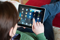 Woman using iPad tablet computer