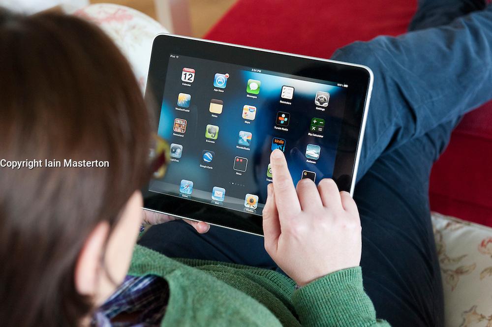 Woman using iPad tablet computer