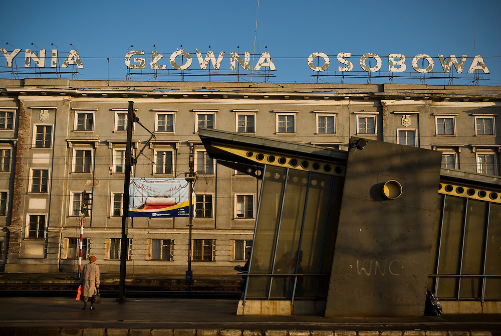 A woman waits on the platform at a train station in Gdynia, Poland. December 2006.