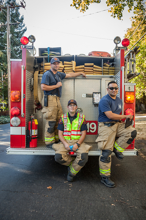 After securing a downed line on a gusty day in Calistoga, Fire Chief Joe Russo with firefighters, Blake McCormick and Jaime Orozco, wait for PG&E to arrive.