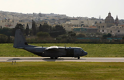 A British Royal Air Force Hercules C-130 transport plane evacuating 51 British citizens and 13 of other nationalities from Tripoli arrives at Malta International Airport outside Valletta February 24, 2011.  .REUTERS/Darrin Zammit Lupi (MALTA)