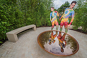 Painted performers on the Perennial Sanctuary Garden by Tom Massey for the Gardeners Royal Bennevolent Society (Painted by body artist Carolyn Roper) - The Hampton Court Flower Show, organised by the Royal Horticultural Society (RHS). In the grounds of the Hampton Court Palace, London.