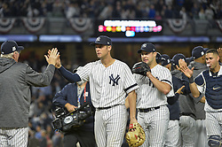 October 18, 2017 - Bronx, NY, USA - The New York Yankees celebrate a 5-0 win against the Houston Astros during Game 5 of the American League Championship Series at Yankee Stadium in New York on Wednesday, Oct. 18, 2017. The Yankees' win gives them a 3-2 series lead. (Credit Image: © Howard Simmons/TNS via ZUMA Wire)