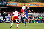 AFC Wimbledon defender Will Nightingale (5) battles for possession during the EFL Sky Bet League 1 match between AFC Wimbledon and Rotherham United at the Cherry Red Records Stadium, Kingston, England on 3 August 2019.