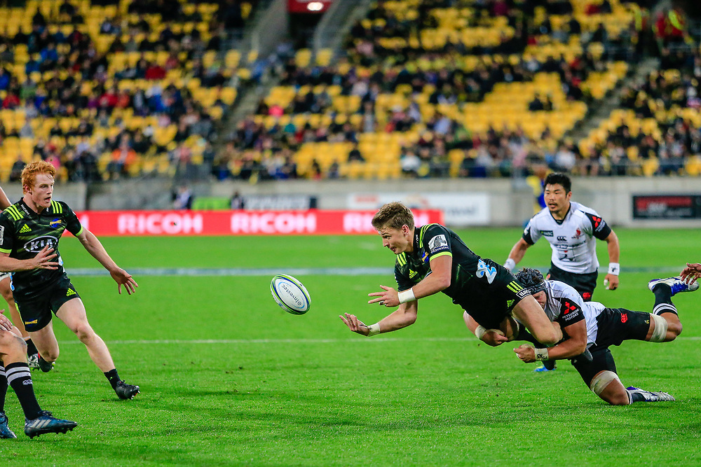 Beauden Barrett passes the ball during the Super Rugby union game between Hurricanes and Sunwolves, played at Westpac Stadium, Wellington, New Zealand on 27 April 2018.   Hurricanes won 43-15.