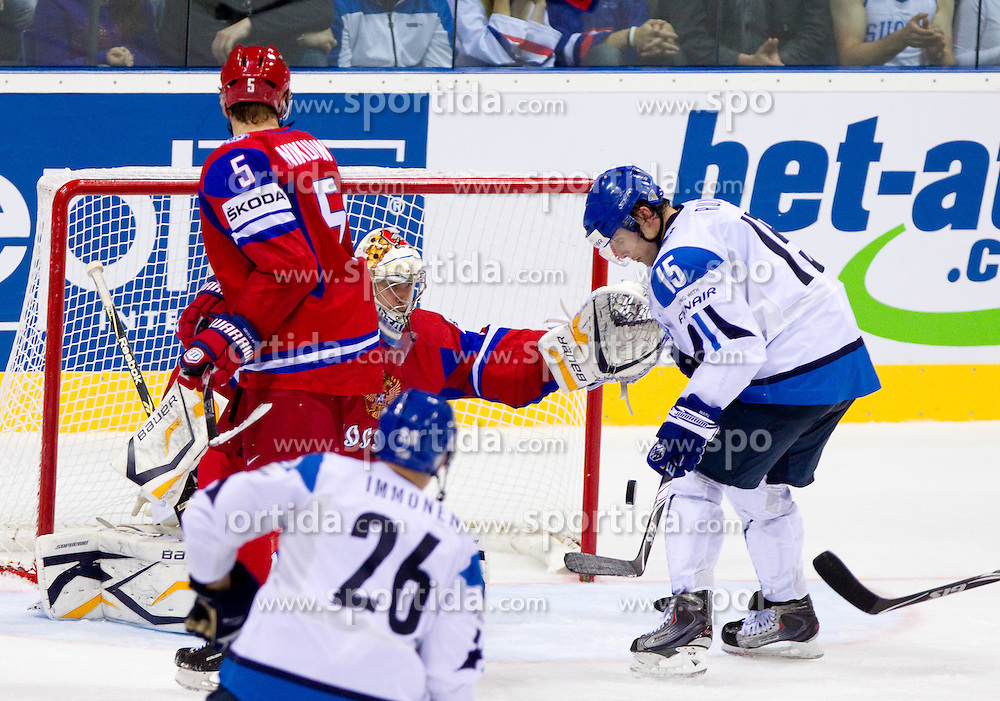 Tuomo Ruutu of Finland (R) vs Konstantin Barulin of Russia during ice-hockey match between Russia and Finland of Group E in Qualifying Round of IIHF 2011 World Championship Slovakia, on May 9, 2011 in Orange Arena, Bratislava, Slovakia. Finland defeated Russia after overtime and shootout 3-2. (Photo By Vid Ponikvar / Sportida.com)