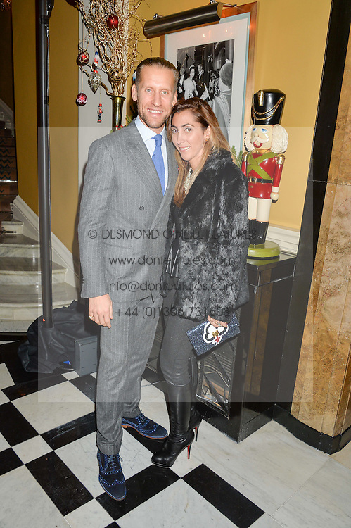 JAKE & SAMIRA PARKINSON-SMITH at a party to celebrate theunveiling of the Claridge's Christmas Tree designed by Christopher Bailey for Burberryheld at Claridge's, Brook Street, London on 18th November 2015.