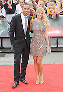 07.JULY.2011. LONDON<br /> <br /> FOOTBALLER THEO WALCOTT WITH GIRLFRIEND MELANIE SLADE AT PREMIERE OF HARRY POTTER AND THE DEATHLY HALLOWS PART 2 IN TRAFALGAR SQUARE<br /> <br /> BYLINE: EDBIMAGEARCHIVE.COM<br /> <br /> *THIS IMAGE IS STRICTLY FOR UK NEWSPAPERS AND MAGAZINES ONLY*<br /> *FOR WORLD WIDE SALES AND WEB USE PLEASE CONTACT EDBIMAGEARCHIVE - 0208 954 5968*
