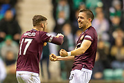 Olly Lee (#8) of Heart of Midlothian celebrates with Benjamin Garuccio (#17) of Heart of Midlothian after scoring a goal during the Ladbrokes Scottish Premiership match between Hibernian FC and Heart of Midlothian FC at Easter Road Stadium, Edinburgh, Scotland on 29 December 2018.