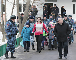 61009840<br /> Police escort children out of a school in northeast Moscow, where a high-school student took fellow pupils hostage and shot a teacher and a police officer dead. The teenager has been detained, Moscow, Russia, Monday, 3rd February 2014. Picture by  imago / i-Images<br /> UK ONLY