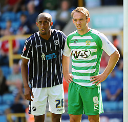 Yeovil Town's James Hayter and Millwall's Nadjim Abdou - Photo mandatory by-line: Seb Daly/JMP - Tel: Mobile: 07966 386802 03/08/2013 - SPORT - FOOTBALL - The Den - Millwall -  Millwall V Yeovil Town - Sky Bet Championship