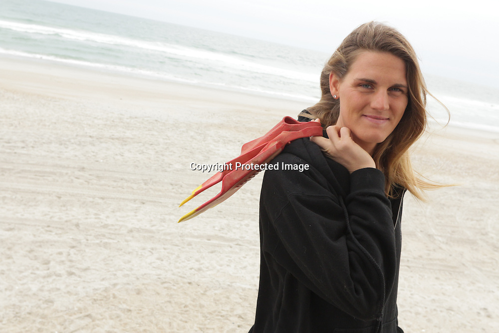 Star-News Circulation Sales and Marketing Manager Kathryn Yarbrough pose for a portrait Sunday December 21, 2014 at Wrightsville Beach, N.C. During the summer months Yarbrough is a lifeguard part-time. (Jason A. Frizzelle)
